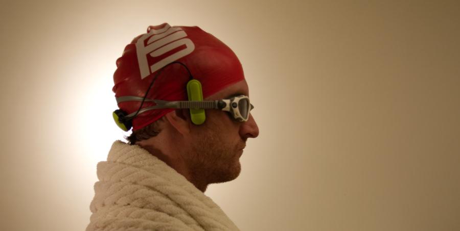 The Platysens Marlin Swim Meter being worn on a swimmer's head