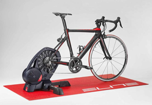 A photograph of a red Elite Cycling Trainer Mat with a road bike attached to an Elite Direto smart cycling trainer