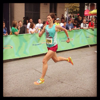 A fast female runner competing in a road race