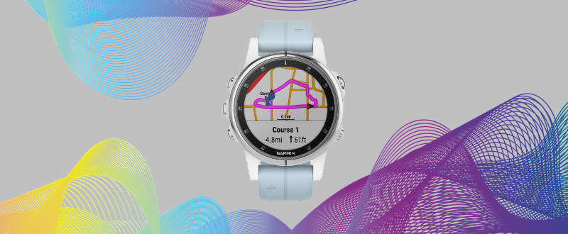 The Garmin Fenix 5 Plus on a graphical background