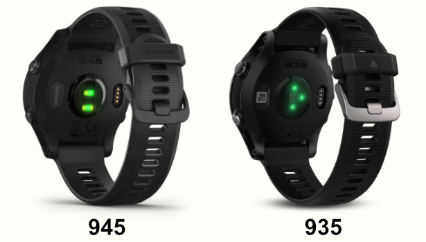 A photo comparing the back of the Garmin Forerunner 945 and 935 triathlon watches