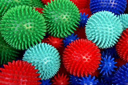 A photograph of various colored spiky massage balls