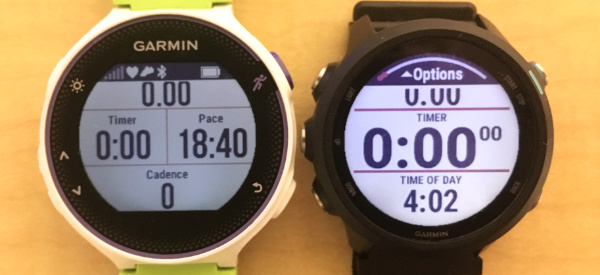 A close-up photo of the Garmin Forerunner 230 next to the Forerunner 245 running watch