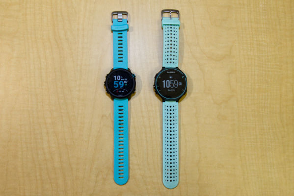 The new Garmin Forerunner 245 Music with Aqua band next to the Forerunner 235 on a wooden surface