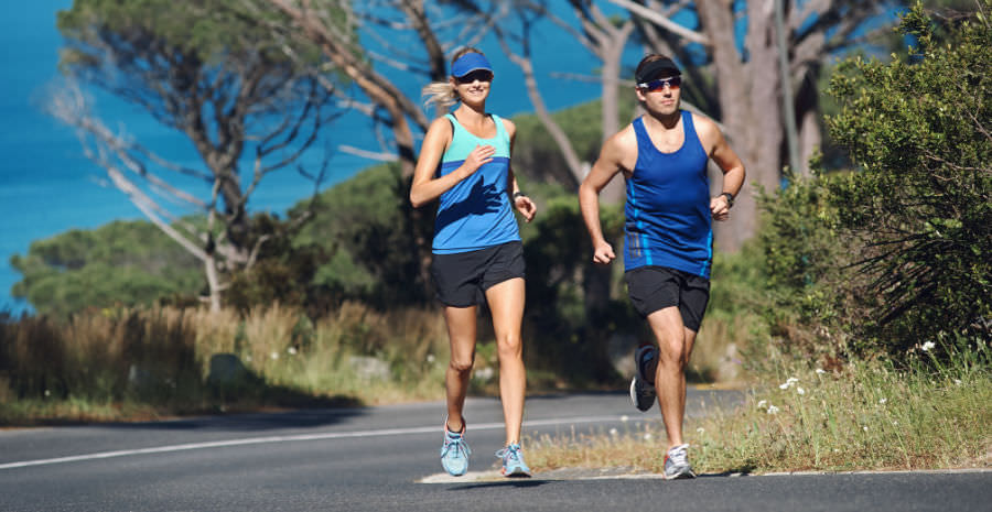 A female and a male running outdoors