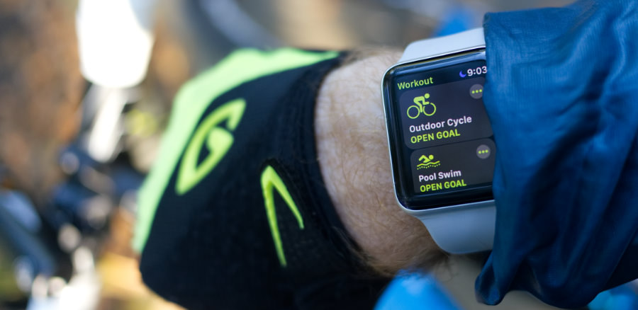 An Apple Watch Series 3 on the wrist of a cyclist