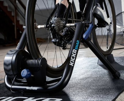 A road bike in the Wahoo KICKR SNAP wheel-on smart trainer