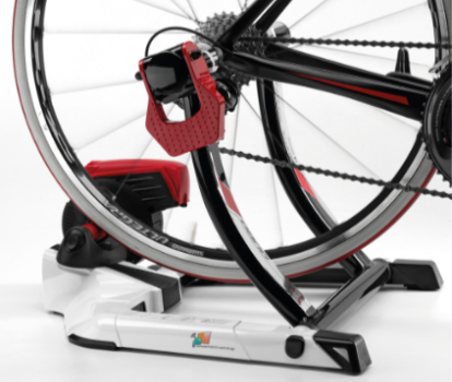 The rear wheel of a road bike in the QUBO Digital Smart B+ smart trainer