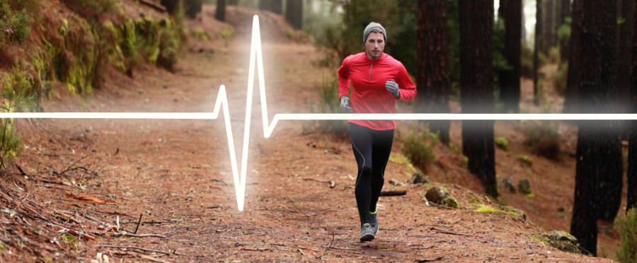 A male runner on a trail with a heart rate graphic overlay