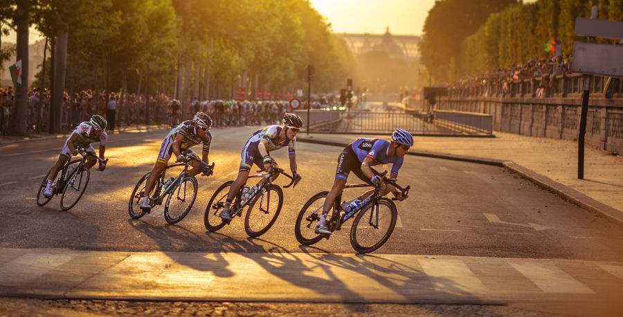 A photograph of a breakaway group of cyclists at a road bike race in a city