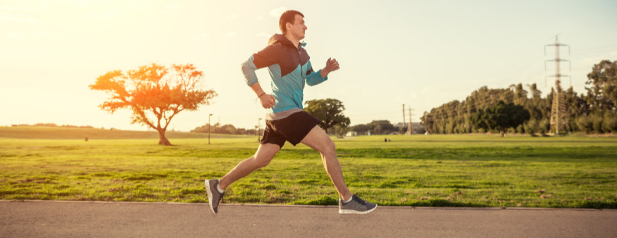 A photograph of a male runner outdoors