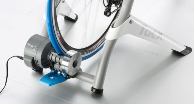 The Tacx Flow Smart bike trainer with a road bike attached