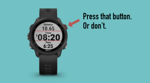 A Garmin Forerunner 245 running watch with an arrow pointing at its Start/Stop button